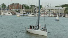 4K Annapolis Sailboat Crew Lowers Sails 1 Stock Footage
