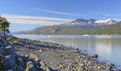 Early Morning Light on a Glacial Lake - stock photo
