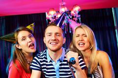 In karaoke bar - stock photo