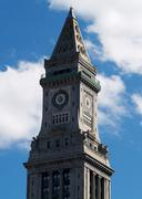Clock Tower High Rise Building Against Blue Sky - stock photo