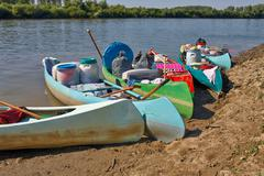 Canoes on the Riverside Stock Photos
