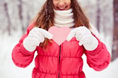 Girl with pink heart - stock photo