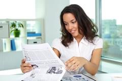 Businesswoman reading news Stock Photos