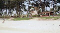Lifeguard hut on tropical beach, Goa, India, long shot Stock Footage