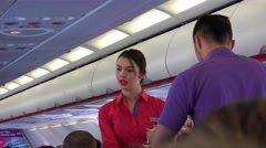 Steward and air hostess serve food and drinks in the passenger cabin Stock Footage