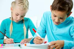 Homework with friend - stock photo