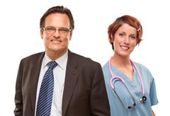 Smiling Businessman with Female Doctor or Nurse Isolated on a White Backgroun - stock photo