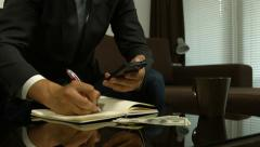 Businessman calculating stock changes and writing info Stock Footage