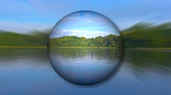 Ambient sphere with lake reflections Stock Footage
