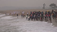 Groups of Hindu and Muslim tourists visit the beach in Tamil Nadu, South India Stock Footage