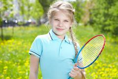 Youthful tennis player - stock photo