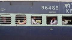 Train travel in India, passengers on moving train, medium shot Stock Footage
