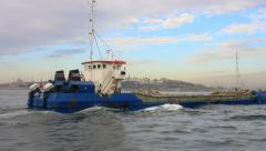 Coaster cargo ship loaded with rock heading up towards Bosphorus Sea Stock Footage