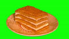 4k small honey cake on saucer Stock Footage