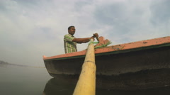Man rowing on boat, view from the vessel in movement. Stock Footage