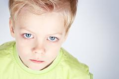 Blue eyed boy Stock Photos