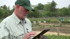 Urban Farmer looking at ipad, close up Stock Footage