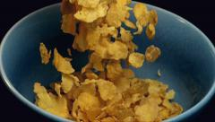 Corn Cereal Falls on Bowl Slow Motion Stock Footage