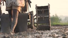 A farmer plows the field with a machine in a village in South India - stock footage