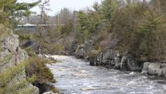 RUSHING RIVER WITH BRIDGE Stock Footage