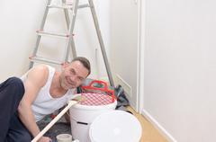 Muscular man doing DIY renovations - stock photo