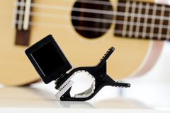 Clip tuner Equipment For tuning the ukulele guitar sound. Stock Photos
