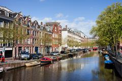 Boats on Amsterdam Canal - stock photo