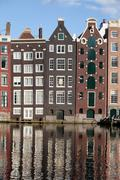 Stock Photo of Houses on Canal in Amsterdam Netherland