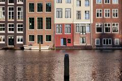 Houses on Water in Amsterdam Netherland Stock Photos