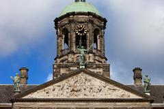 Pediment and Tower of the Royal Palace in Amsterdam Stock Photos