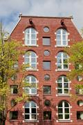 Stock Photo of Arched and Round Windows House in Amsterdam