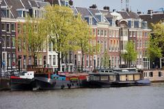 Stock Photo of Houseboats and Houses in Amsterdam