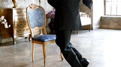 Man and chair, tango dance Stock Footage