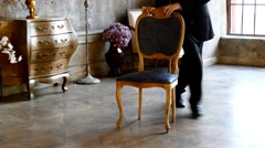 Man dancing with antique chair Stock Footage