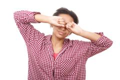 Young woman rubbing her eyes - stock photo