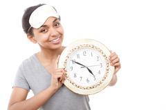 Pretty mulatto girl posing with clock - stock photo