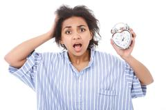 Excited young woman with alarm clock Stock Photos