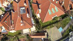 Aerial view of residential blocks and suburban neighborhood from low flying came - stock footage