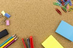 Stock Photo of Stationary on cork board