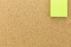 green post it on cork board - stock photo