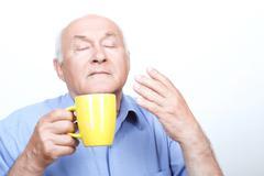 Nice grandfather smelling tea aroma Stock Photos