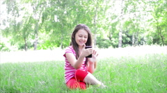 Kid playing with a mobile phone Stock Footage