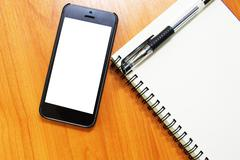 Office table with mobile phone Stock Photos