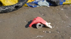 Contamination in marine currents drag garbage to beach. Handheld close up shot - stock footage