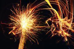 Yellow Color Firework Light Up Night Sky - stock photo