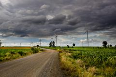 Wind turbines, pure energy,windmills in the fields in Thailand Stock Photos