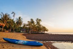 Stock Photo of Kayak on the shore of a tropical beach on the island