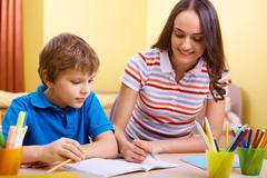 Schoolwork with mother Stock Photos