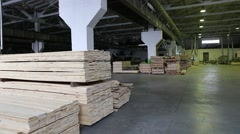 Warehouse timber plant. Boards on the shelves inside the hangar Stock Footage