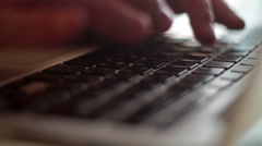 businessman typing on a keyboard, shallow depth of field - stock footage